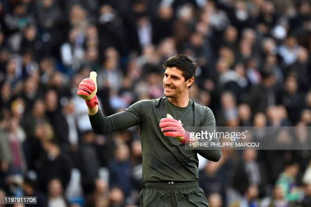 Real Madrid's Belgian goalkeeper Thibaut Courtois celebrates his team's win at the end of the Spanish league football match between Real Madrid CF...