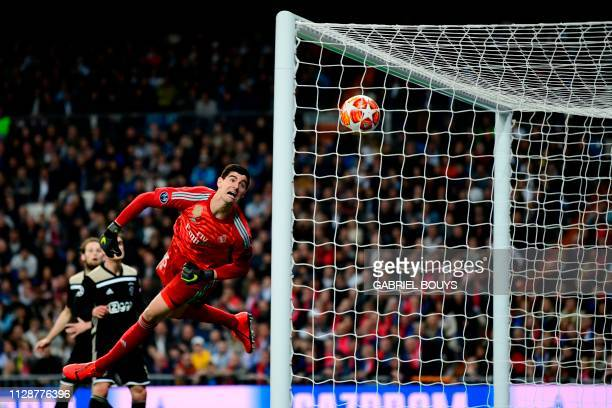 Real Madrid's Belgian goalkeeper Thibaut Courtois concedes a fourth goal during the UEFA Champions League round of 16 second leg football match...