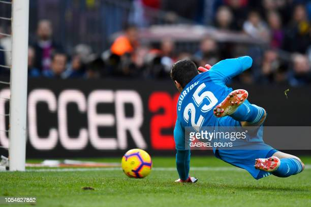 Real Madrid's Belgian goalkeeper Thibaut Courtois concedes the opener during the Spanish league football match between FC Barcelona and Real Madrid...