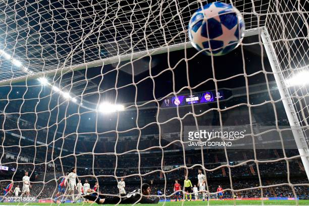 Real Madrid's Belgian goalkeeper Thibaut Courtois concedes the third goal during the UEFA Champions League group G football match between Real Madrid...