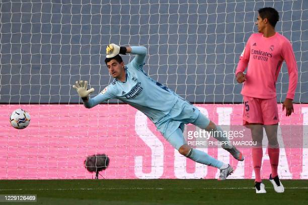 Real Madrid's Belgian goalkeeper Thibaut Courtois dives for the ball during the Spanish League football match between Real Madrid CF and Cadiz CF at...
