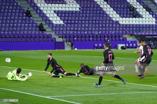 Real Madrid's Belgian goalkeeper Thibaut Courtois dives for the ball during the Spanish league football match between Real Valladolid FC and Real...