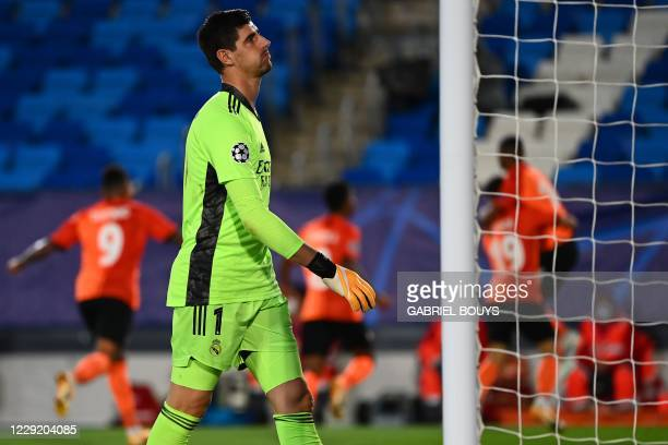 Real Madrid's Belgian goalkeeper Thibaut Courtois reacts after conceding a third goal during the UEFA Champions League group B football match between...