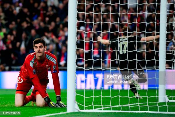 Real Madrid's Belgian goalkeeper Thibaut Courtois reacts as he concedes a fourth goal during the UEFA Champions League round of 16 second leg...
