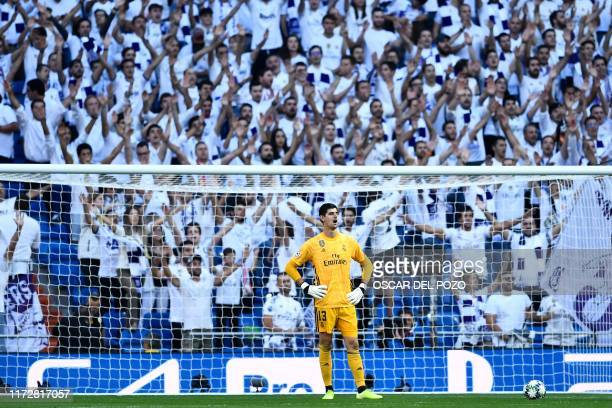 Real Madrid's Belgian goalkeeper Thibaut Courtois reacts during the UEFA Champions league Group A football match between Real Madrid and Club Brugge...