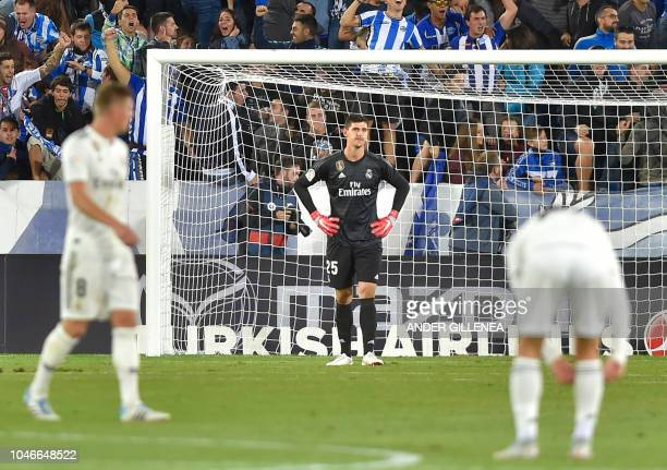 Real Madrid's Belgian goalkeeper Thibaut Courtois reacts to conceding a goal during the Spanish league football match between Deportivo Alaves and...
