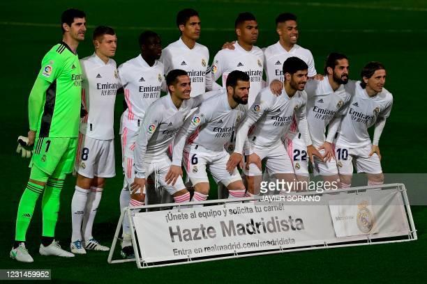 Real Madrid's Belgian goalkeeper Thibaut Courtois, Real Madrid's German midfielder Toni Kroos, Real Madrid's French defender Ferland Mendy, Real...