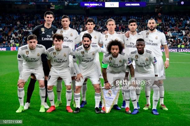 Real Madrid's Belgian goalkeeper Thibaut Courtois, Real Madrid's Spanish defender Javier Sanchez, Real Madrid's Spanish defender Jesus Vallejo, Real...