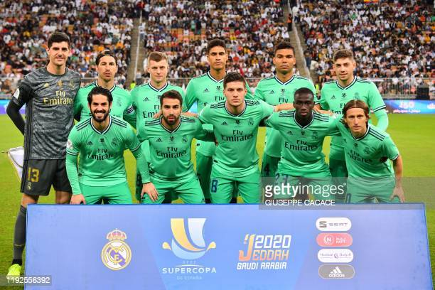 Real Madrid's Belgian goalkeeper Thibaut Courtois Real Madrid's Spanish defender Sergio Ramos Real Madrid's German midfielder Toni Kroos Real...