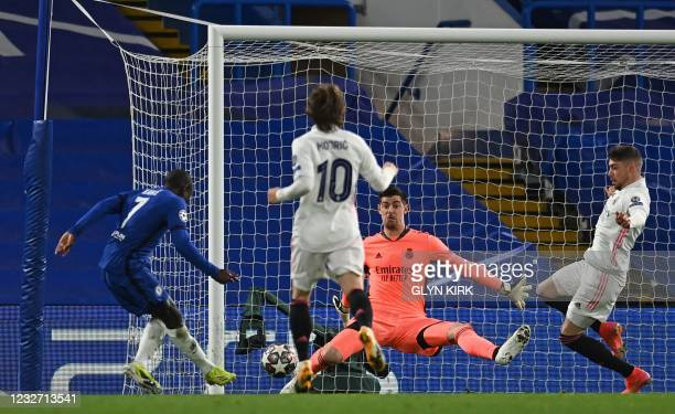 Real Madrid's Belgian goalkeeper Thibaut Courtois saves a shot from Chelsea's French midfielder N'Golo Kante during the UEFA Champions League second...