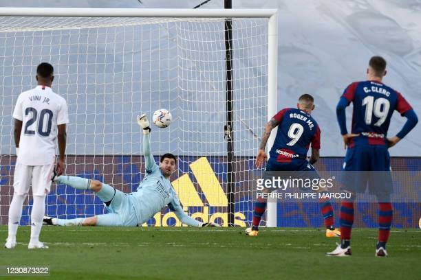 Real Madrid's Belgian goalkeeper Thibaut Courtois stops a penalty kick during the Spanish league football match Real Madrid CF against Levante UD at...