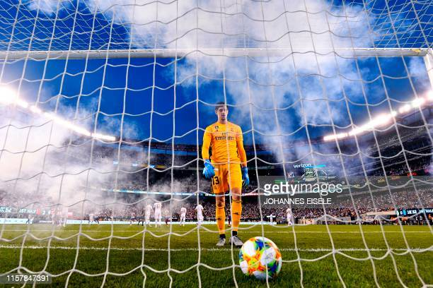Real Madrid's Belgian goalkeeper Thibaut Courtois takes the ball after failing to save a goal during the 2019 International Champions Cup football...