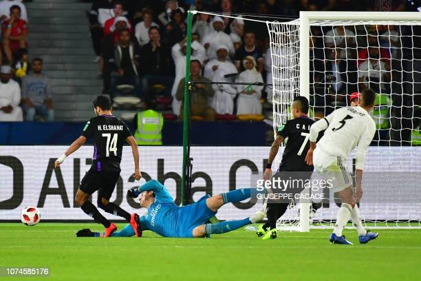 Real Madrid's Belgian goalkeeper Thibaut Courtois vies for the ball with AlAin's midfielder Hussein elShahat during the Final match in the FIFA Club...