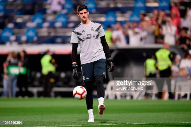 Real Madrid's Belgian goalkeeper Thibaut Courtois warms up before the Spanish League football match between Real Madrid and Getafe at the Santiago...