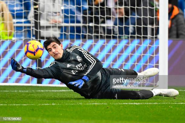 Real Madrid's Belgian goalkeeper Thibaut Courtois warms up before the Spanish League football match between Real Madrid CF and Real Sociedad at the...