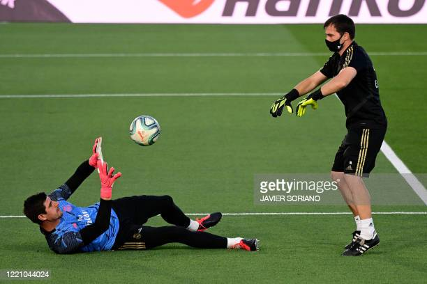 Real Madrid's Belgian goalkeeper Thibaut Courtois warms up before the Spanish league football match between Real Madrid CF and Valencia CF at the...