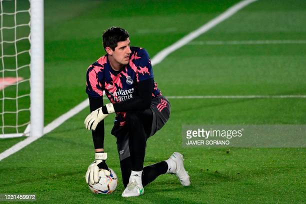 Real Madrid's Belgian goalkeeper Thibaut Courtois warms up before the Spanish league football match between Real Madrid and Real Sociedad at the...