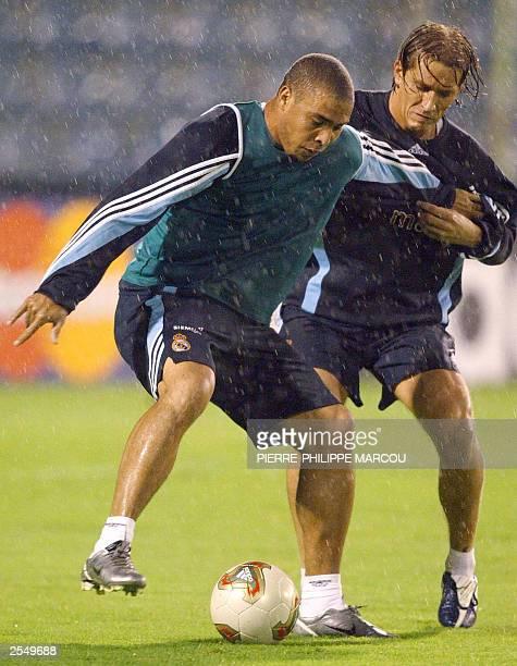 Real Madrid's brasilian player, Ronaldo fights for the ball With his teammate, Michel Salgado , 30 September 2003 in Das Antas Stadium in Porto,...