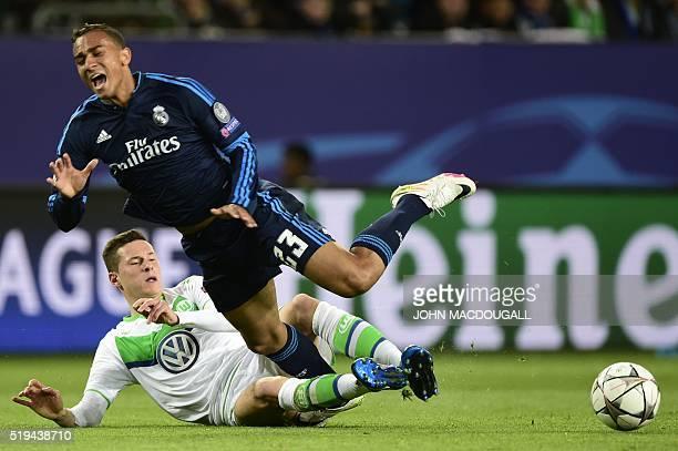 Real Madrid's Brazilian defender Danilo and Wolfsburg's midfielder Julian Draxler vie for the ball during the UEFA Champions League quarterfinal...