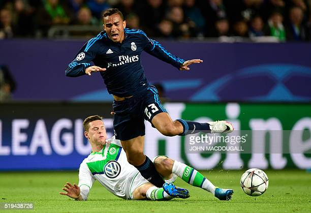 Real Madrid's Brazilian defender Danilo and Wolfsburg's midfielder Julian Draxler vie for the ball during the UEFA Champions League quarterfinal...