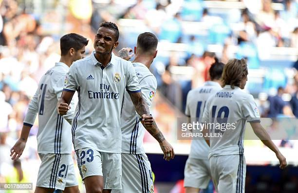 Real Madrid's Brazilian defender Danilo celebrates after scoring during the Spanish league football match Real Madrid CF vs CA Osasuna at the...