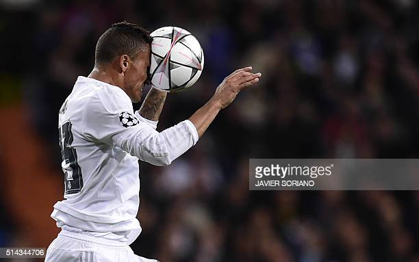 Real Madrid's Brazilian defender Danilo heads the ball during the UEFA Champions League round of 16 second leg football match Real Madrid FC vs AS...