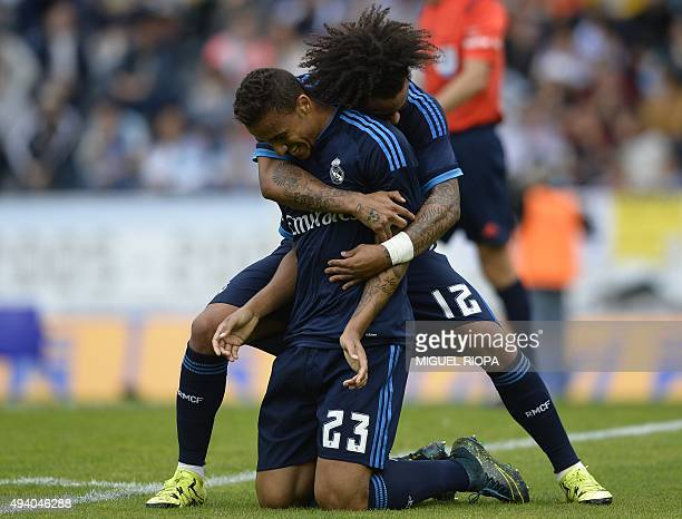 Real Madrid's Brazilian defender Danilo is congratulated by Brazilian defender Marcelo after scoring a goal during the Spanish league football match...