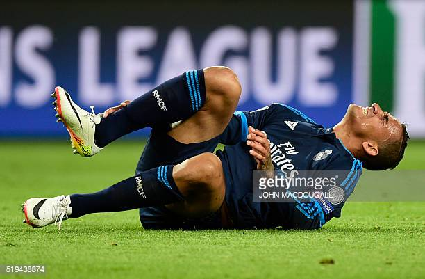 Real Madrid's Brazilian defender Danilo reacts during the UEFA Champions League quarterfinal firstleg football match between VfL Wolfsburg and Real...