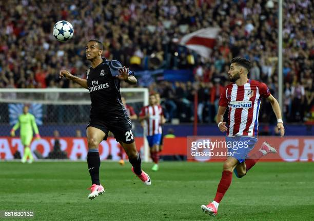 Real Madrid's Brazilian defender Danilo vies with Atletico Madrid's Belgian midfielder Yannick Ferreira Carrasco during the UEFA Champions League...