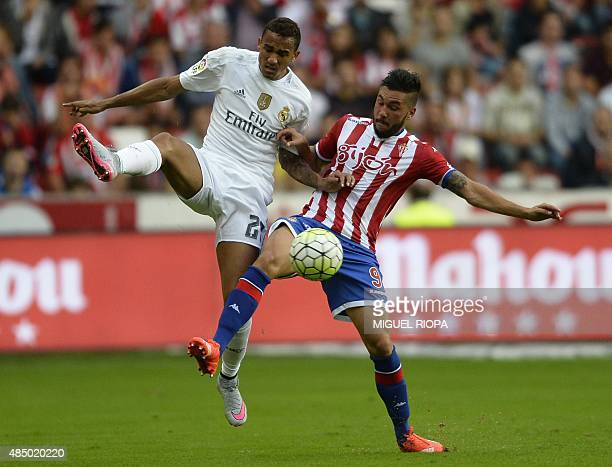 Real Madrid's Brazilian defender Danilo vies with Sporting Gijon's forward Miguel Angel Guerrero Martin during the Spanish league football match...