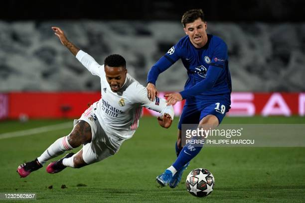Real Madrid's Brazilian defender Eder Militao vies with Chelsea's English midfielder Mason Mount during the UEFA Champions League semi-final first...