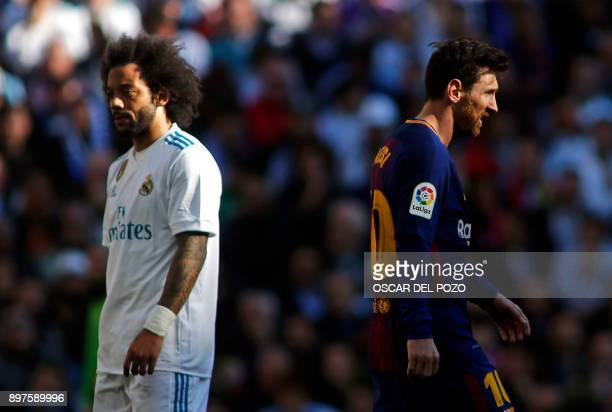 Real Madrid's Brazilian defender Marcelo and Barcelona's Argentinian forward Lionel Messi react during the Spanish League 'Clasico' football match...