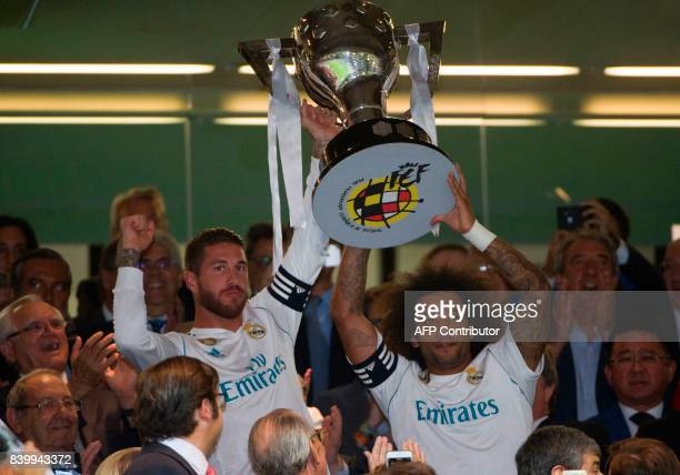 Real Madrid's Brazilian defender Marcelo and Real Madrid's defender Sergio Ramos hold the Spanish League cup before the Spanish league football match...