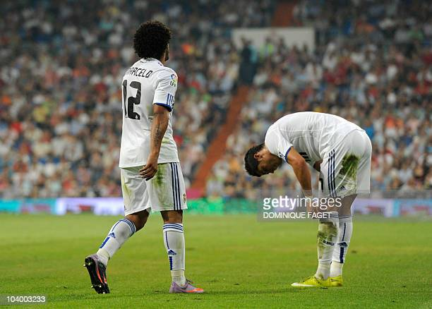Real Madrid's Brazilian defender Marcelo and Real Madrid's Portuguese forward Cristiano Ronaldo react during their Spanish league football match...