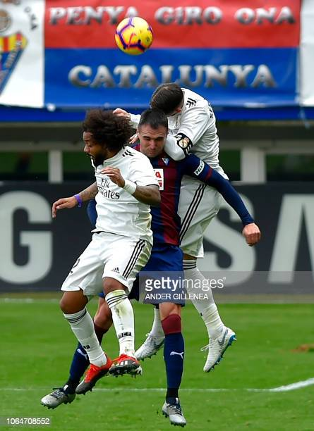 Real Madrid's Brazilian defender Marcelo and Spanish defender Sergio Ramos vie with Eibar's Spanish forward Kike Garcia during the Spanish league...
