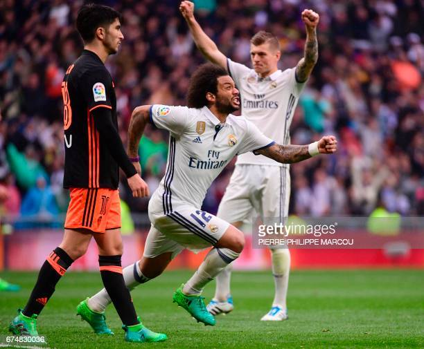 Real Madrid's Brazilian defender Marcelo celebrates a goal during the Spanish league football match Real Madrid CF vs Valencia CF at the Santiago...