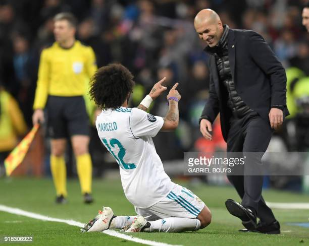 TOPSHOT Real Madrid's Brazilian defender Marcelo celebrates a goal with Real Madrid's French coach Zinedine Zidane during the UEFA Champions League...
