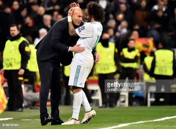 Real Madrid's Brazilian defender Marcelo celebrates a goal with Real Madrid's French coach Zinedine Zidane during the UEFA Champions League round of...