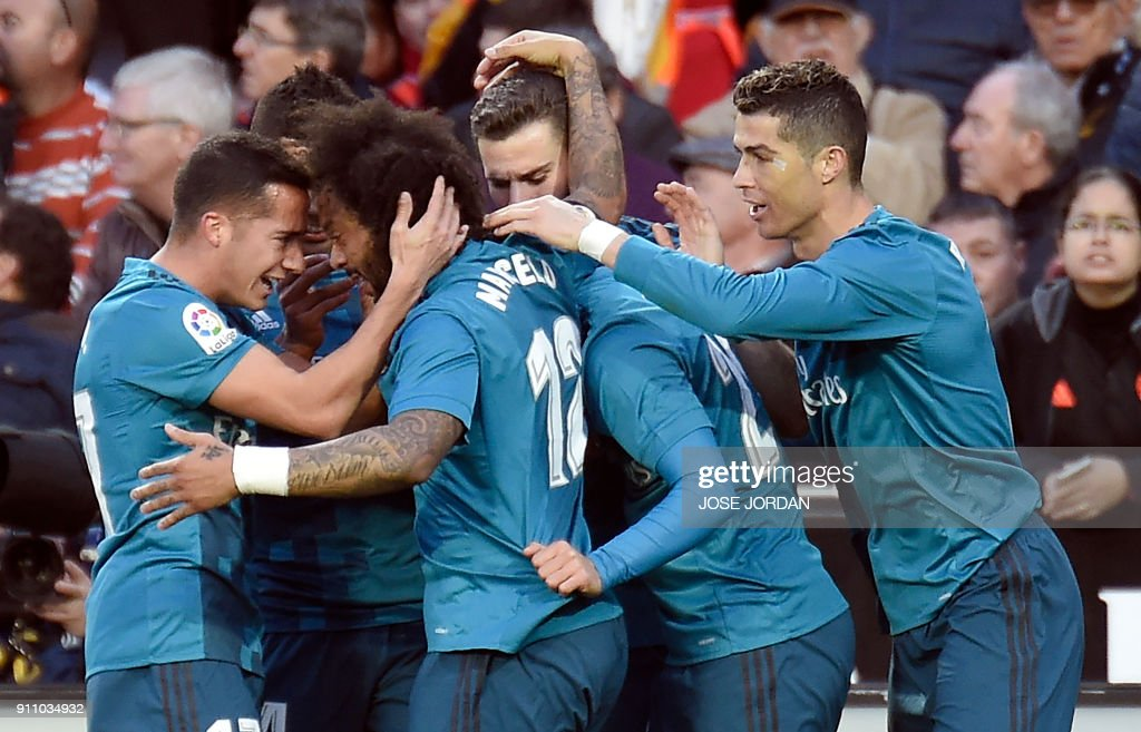 Real Madrid's Brazilian defender Marcelo (2L) celebrates a goal with teammates during the Spanish league football match between Valencia CF and Real Madrid CF at the Mestalla stadium in Valencia on January 27, 2018. /