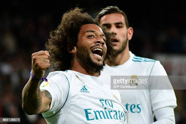 TOPSHOT Real Madrid's Brazilian defender Marcelo celebrates after scoring his team's third goal during the Spanish league football match Real Madrid...