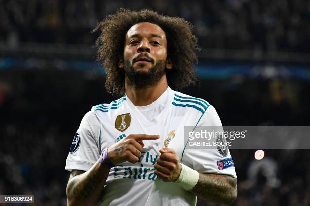 Real Madrid's Brazilian defender Marcelo celebrates after scoring during the UEFA Champions League round of sixteen first leg football match Real...