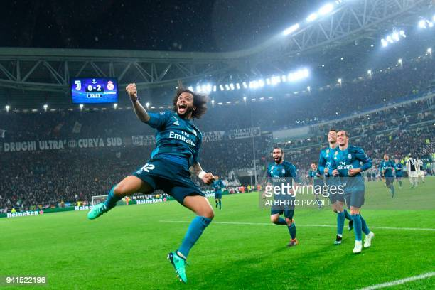 TOPSHOT Real Madrid's Brazilian defender Marcelo celebrates after scoring during the UEFA Champions League quarterfinal first leg football match...