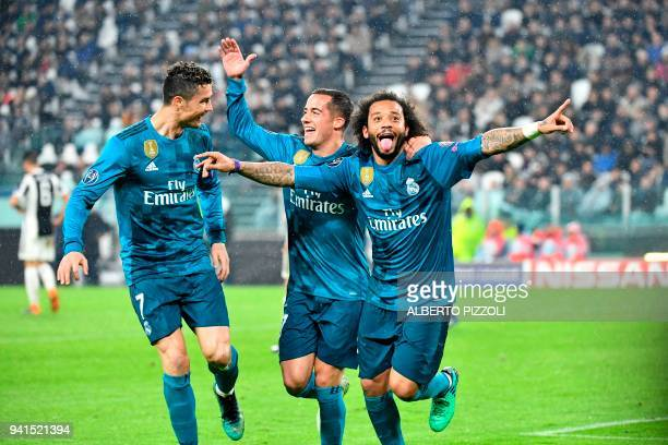 Real Madrid's Brazilian defender Marcelo celebrates after scoring with Real Madrid's Spanish midfielder Lucas Vazquez and Real Madrid's Portuguese...