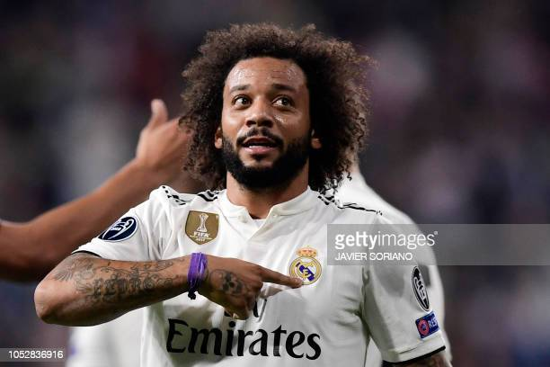 Real Madrid's Brazilian defender Marcelo celebrates his team's second goal during the UEFA Champions League group G football match between Real...