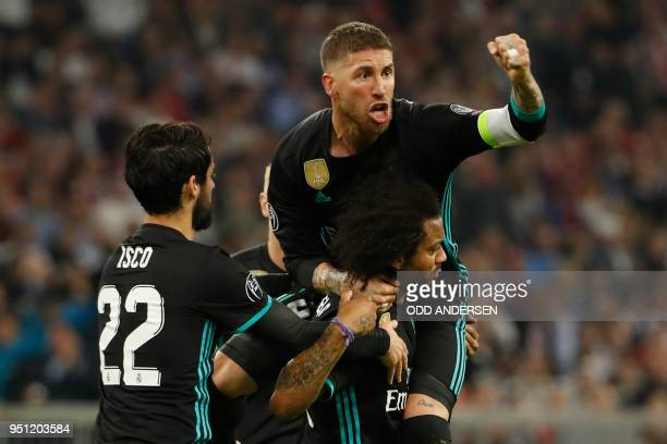 Real Madrid's Brazilian defender Marcelo celebrates scoring with his teammates Real Madrid's Spanish midfielder Isco and Real Madrid's Spanish...