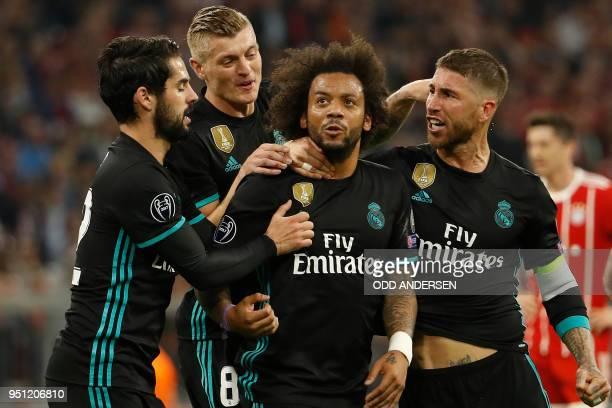 Real Madrid's Brazilian defender Marcelo celebrates scoring with his teammates Real Madrid's Spanish midfielder Isco Real Madrid's German midfielder...