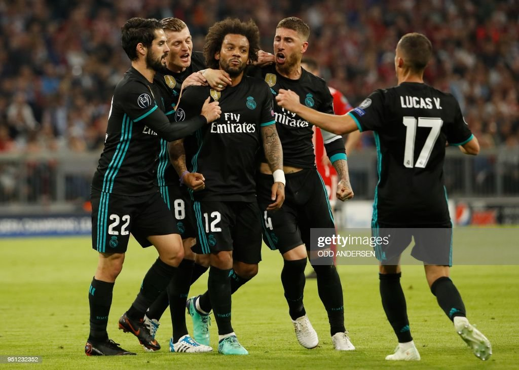 Real Madrid's Brazilian defender Marcelo (C) celebrates scoring with his team-mates Real Madrid's Spanish midfielder Isco (L), Real Madrid's German midfielder Toni Kroos, Real Madrid's Spanish defender Sergio Ramos and Real Madrid's Spanish midfielder Lucas Vazquez (R) during the UEFA Champions League semi-final first-leg football match FC Bayern Munich v Real Madrid CF in Munich, southern Germany on April 25, 2018.