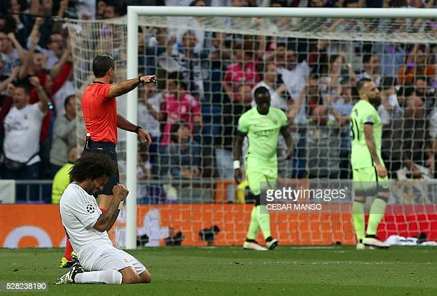 Real Madrid's Brazilian defender Marcelo celebrates their opener during the UEFA Champions League semifinal second leg football match Real Madrid CF...