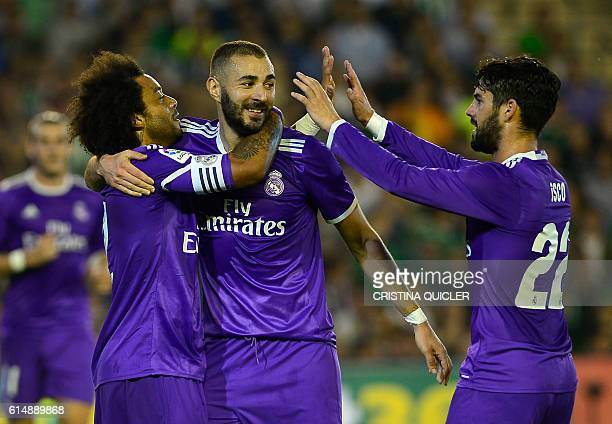 Real Madrid's Brazilian defender Marcelo celebrates with Real Madrid's French forward Karim Benzema and Real Madrid's midfielder Isco after scoring...
