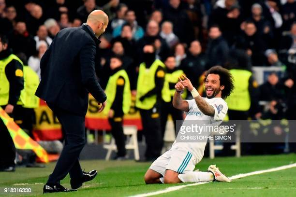 TOPSHOT Real Madrid's Brazilian defender Marcelo celebrates with Real Madrid's French coach Zinedine Zidane after scoring during the UEFA Champions...